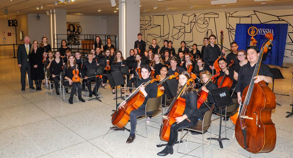 Assemblyman Fred W. Thiele Jr. pictured with students from the Southampton String Orchestra who performed on Wednesday, March 16, 2016 on the South Concourse of the Empire State Plaza in Albany in cel