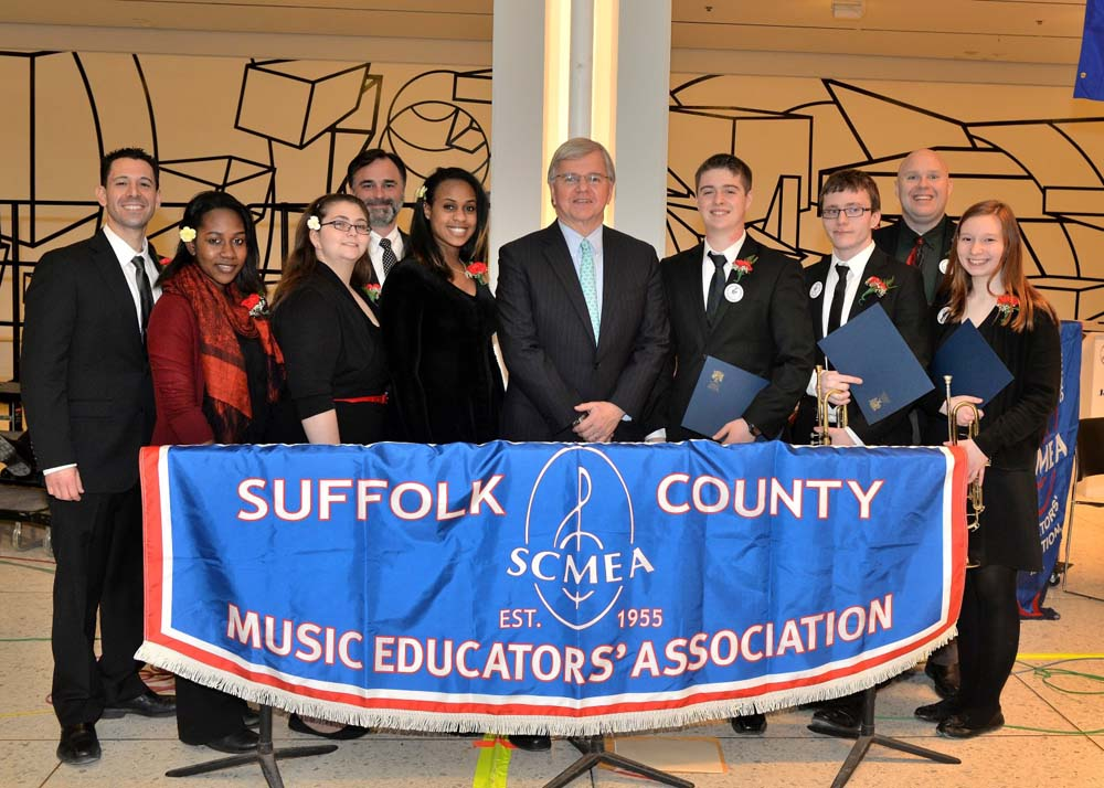 Assemblyman Fred W. Thiele, Jr. pictured with local high school students who performed with the Suffolk County Music Educators� Association (SCMEA) All-County Instrumental and Vocal Jazz Ensembles on