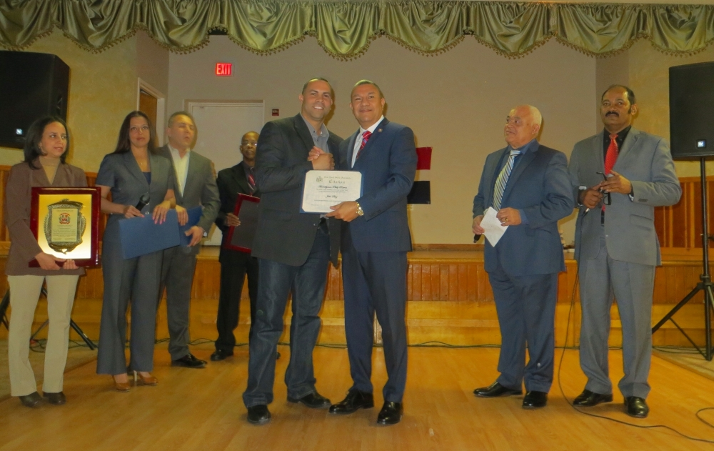 Assemblyman Phil Ramos congratulates Julio Diaz, a Dominican small business owner, who was honored at the Herencia Dominicana event held on February 22, 2015 at the Long Island Portuguese-American Cen