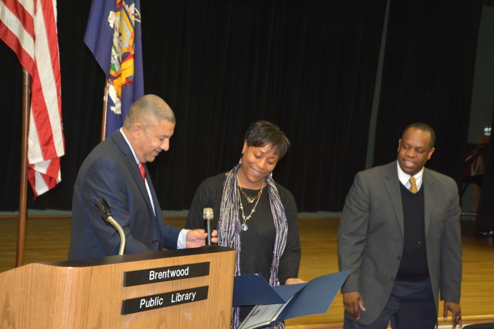 Assemblyman Ramos presents an award to Paula Santorelli during his 4th Annual Black History month celebration on February 18, 2015.