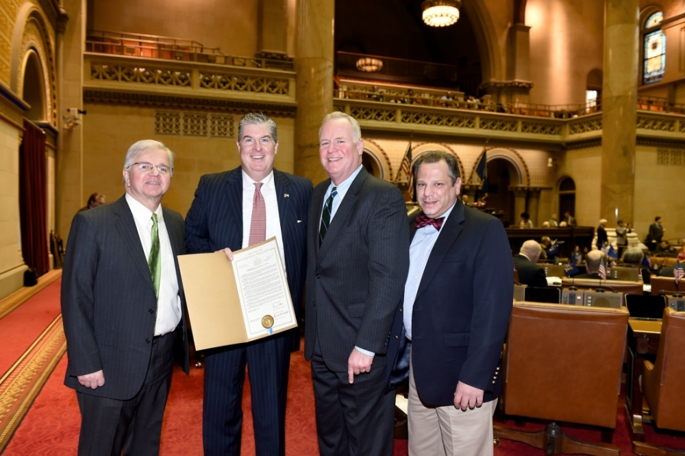 Assemblyman Fred Theile, Jr., Kevin McCrudden of Smithtown, Assemblyman Michael Fitzpatrick (R,C,I-Smithtown), and Assemblyman Andrew Raia (R,I,C-East Northport) take a photo to commemorate the Assemb