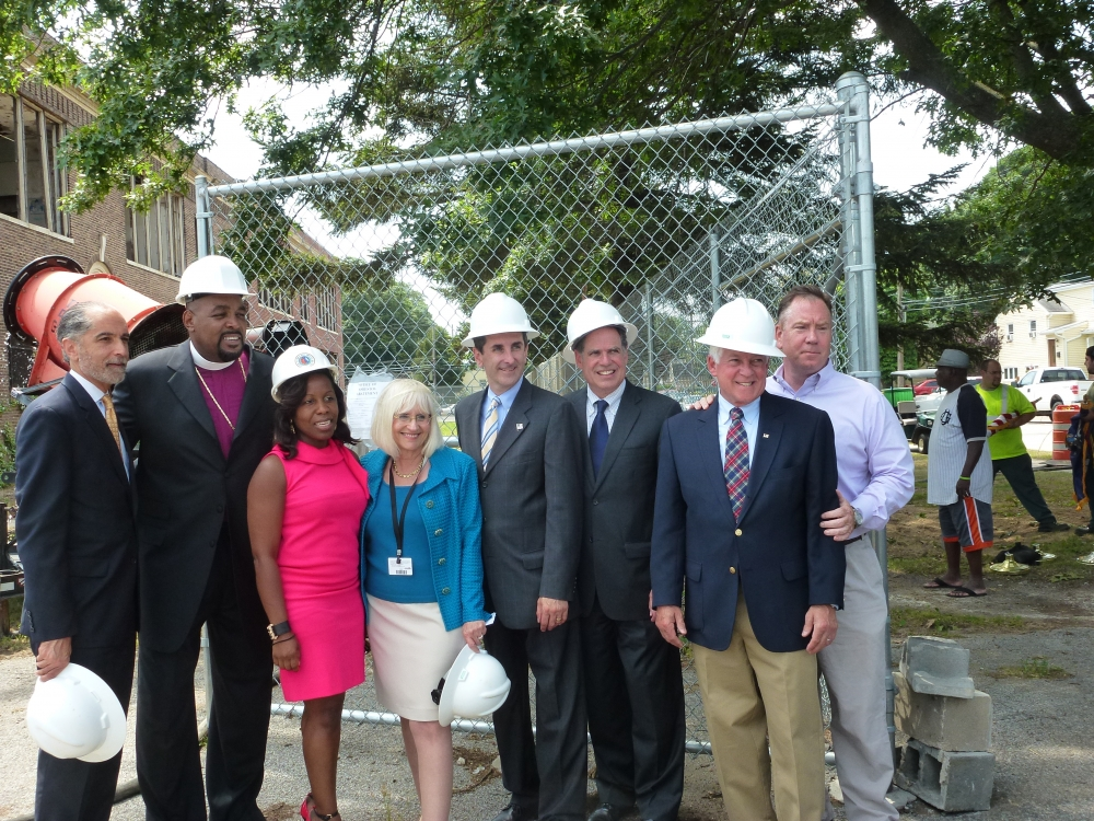Assemblyman Charles Lavine (D-Glen Cove) second from right, joined officials from the Town of North Hempstead at the demolition of the Grand Street School in New Cassel. The school, which has been vac