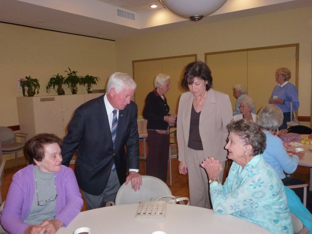 Assemblyman Charles Lavine (D-Glen Cove) talks to some of the seniors at the Life Enrichment Center at Oyster Bay during a recent visit. He was joined by Silvana LaFerlita Gullo, Executive Director. T