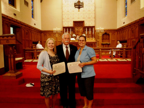 Assemblyman Charles D. Lavine presented teachers Elyse Pollitt and Karen Lively of Trinity Lutheran School in Hicksville with citations from the New York State Assembly for their heroism in keeping a busload of students safe following an incident in which the bus caught fire in heavy traffic. Assemblyman Lavine said, �Elyse and Karen showed remarkable courage and maturity when faced with this frightening situation. Thanks to their quick thinking, not one child was hurt. Perhaps equally as important, the young teachers acted with confidence and composure, serving as exemplary role models for their students. Our community is indeed lucky to have teachers of the caliber of Karen and Elyse working with our children.�