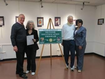 Assemblyman Dave McDonough (left) joins Town of Hempstead Clerk Nasrin Ahmad (right) and Elaine and Walter Klausner during the Senior ID event.