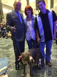 Assemblyman Dave McDonough with Hudson, a pit bull who was brutally injured by his owner at only 3 months old.