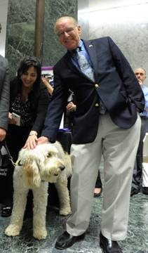Assemblyman Dave McDonough (R,C,I-Merrick) meets a friendly dog at Animal Advocacy Day in Albany on Wednesday.