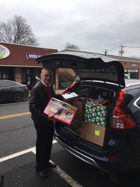 Assemblyman Dave McDonough (R,C,I-Merrick) is seen loading his car with many toy donations on the way to the John Theissen Children's Foundation.