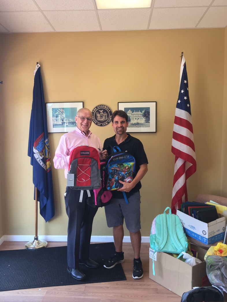 John Theissen [right] picks up donations of Assemblyman Dave McDonough's annual school supply drive.