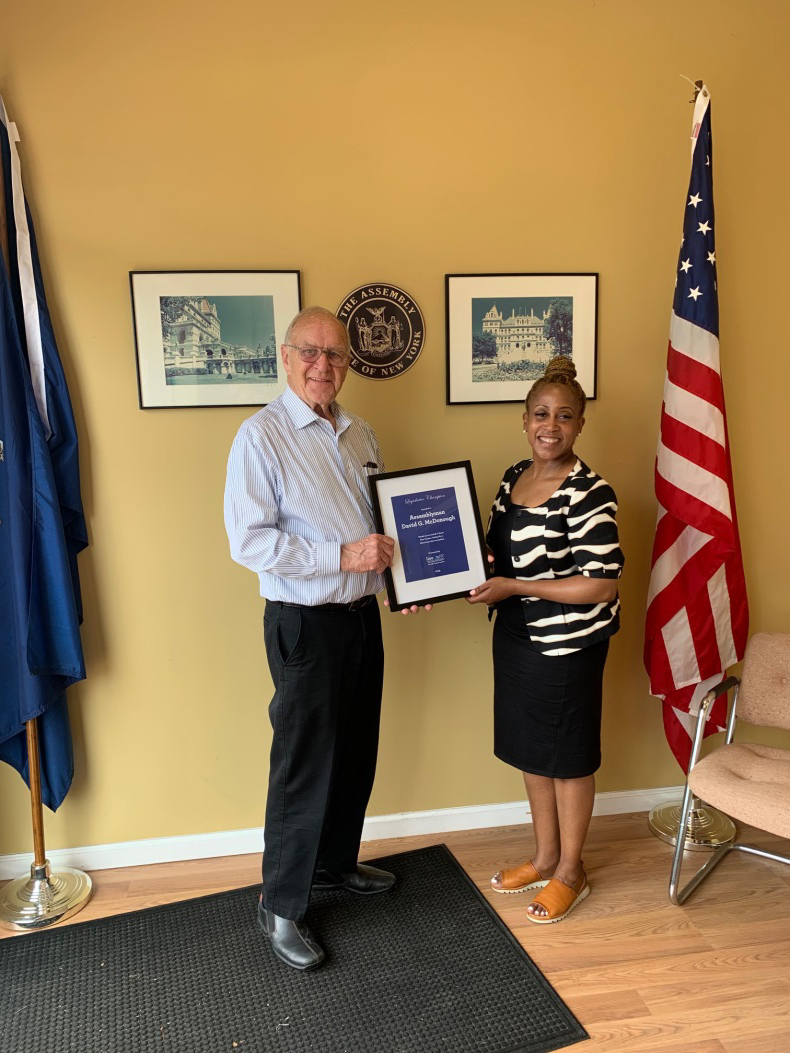 Assemblyman Dave McDonough(R,C,I-Merrick) [pictured left] accepting a plague of recognition from Karen Cummings of LiveOnNY.