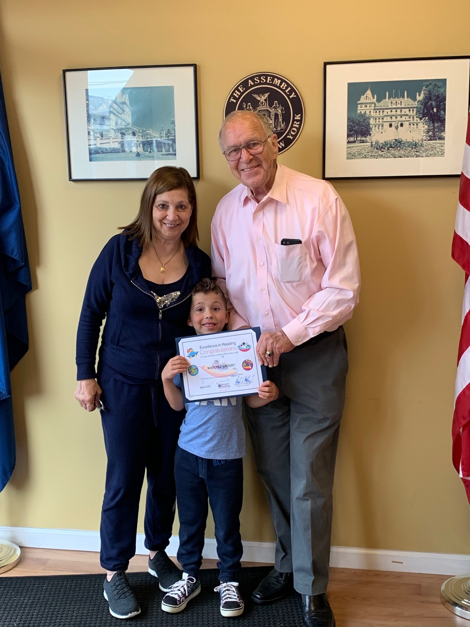 Assemblyman Dave McDonough (R,C,I-Merrick) pictured with Michael Grosso [center] and his Grandmother Angela Curro [left] with Michael's Summer Reading certificate.