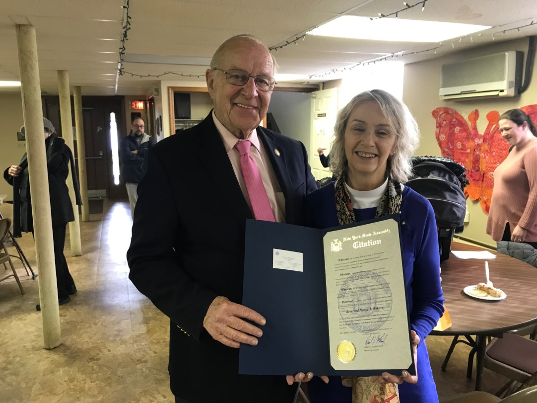 Assemblyman Dave McDonough presents Rev. Nancy A. Rakoczy with an official Assembly Citation recognizing her work and achievements.