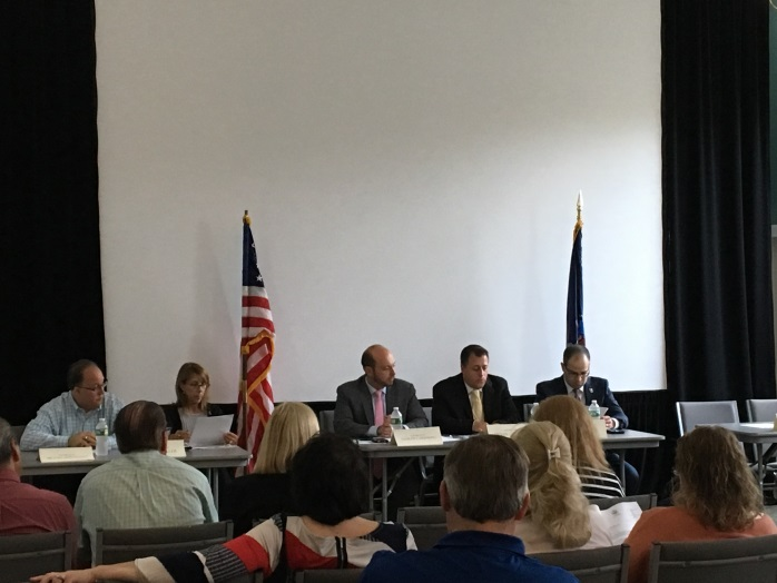 Assemblyman Michael Montesano, Assemblywoman Melissa Miller, Assemblyman Andrew Garbarino, Assemblyman Brian Curran and Assemblyman Ed Ra at a forum on proposed regulations for title closers.