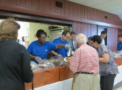 Assemblyman Ed Ra serves guests at his Veterans BBQ