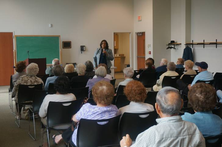 Assemblywoman Solages shares resources with local seniors at an AARP meeting.