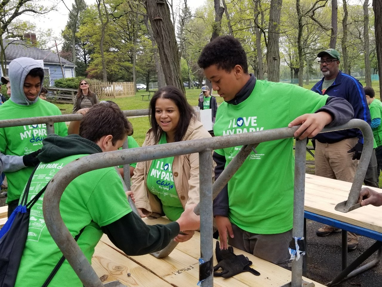 Constituents work with Assemblywoman Solages to build picnic tables at the Valley Stream State Park on I Love My Parks Day.