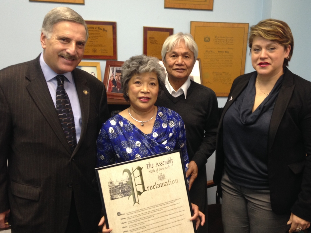 Assemblyman Weprin and the AARP honor Editha Santiago, a retired nurse and full time caregiver, with a New York State Assembly Proclamation and the AARP I ♥ Caregivers award.