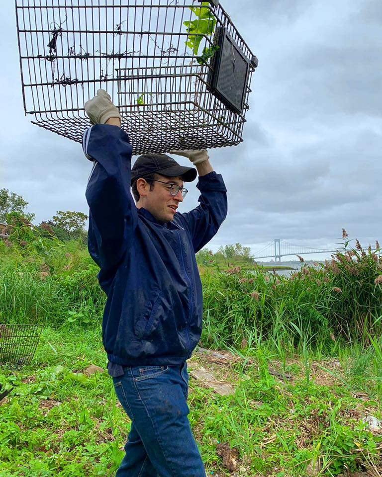 Assemblymember Rosenthal lends a hand to the Coastal Preservation Network in extracting shopping carts embedded into the sand at Powell's Cove Park in College Point.