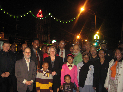 Assemblywoman Helene Weinstein,  Councilman Jumaane Williams, Terrence LaPierre, President of the Avenue D Merchants and CB#17 Chair Lloyd Mills, community leaders and members at the Annual Avenue D Holiday Lighting Ceremony. The lighting project co-sponsored by the Assemblywoman helps beautify Avenue D making it a more welcoming destination for shoppers during the holiday season.