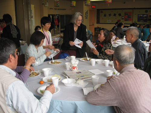 Assemblywoman Helene Weinstein visits with members of Homecrest Senior Center to distribute Chinese language materials her office offers.