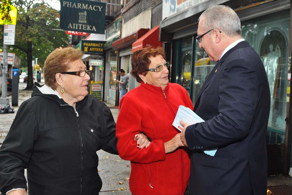 Assemblyman Steven Cymbrowitz greets constituents on Avenue U in the heart of his district.