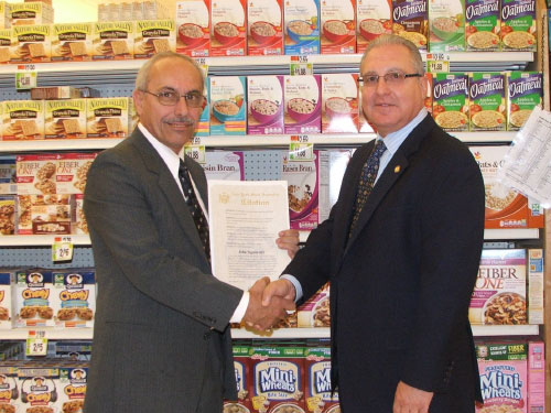 Citing the community spirit and compassion that Stop and Shop Manager John Signoretti has shown by hiring students with special needs and helping them make their work experience successful, Assemblyman presented him with a NYS Assembly Citation.