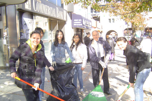Assemblyman Colton is seen here working with youths to clean-up one of the many street corners that the Speak-Up to Clean-Up Neighborhood Campaign has targeted.