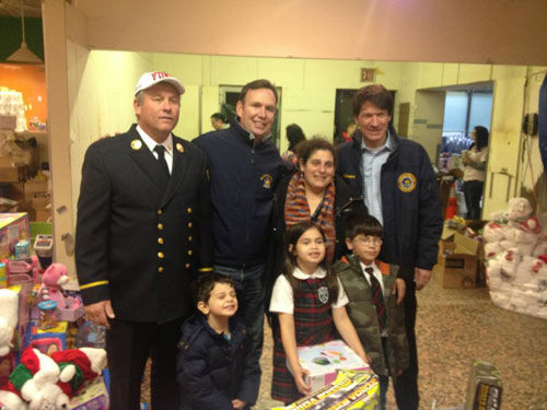 Siller Foundation, Assemblyman Cusick, Commissioner Kenneth Adams, and a family from the New Dorp affected area getting toys for the holidays thanks to Governor Cuomo's efforts in Staten Island.