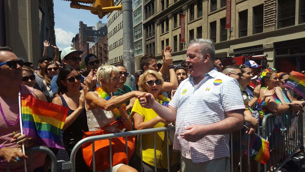 Assemblymember O'Donnell engages with the crowd at the 2016 NYC Pride Parade.