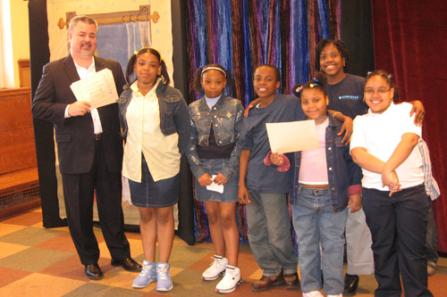 O�Donnell presents certificates of recognition to district readers who participated in his Annual Community Reading Challenge. Local branch libraries host parties celebrating the readers� efforts.