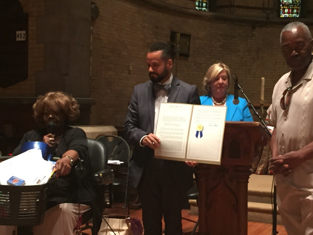 August 5, 2015— Chapel of the Good Shepherd, Roosevelt Island ---State Senator Serrano presents the official proclamation inducting former Roosevelt Island Resident, Dominic Sciallo, into the 2015 NYS Senate Veterans Hall of Fame.