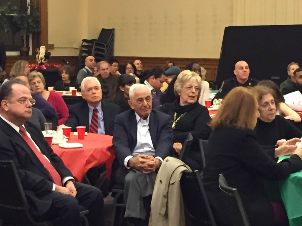 December 7, 2015--- Holy Trinity Church, Upper East Side ---The crowd at the 19th Precinct holiday party.