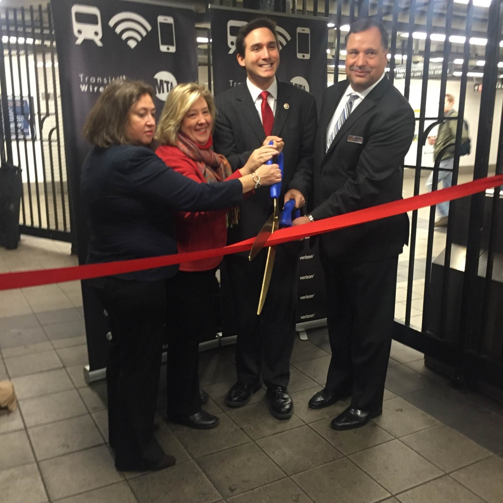 December 8, 2015---86th Street Uptown Lexington Line---Assembly Member Rebecca A. Seawright welcomes Transit Wireless Wifi with the MTA and Council Member Ben Kallos.