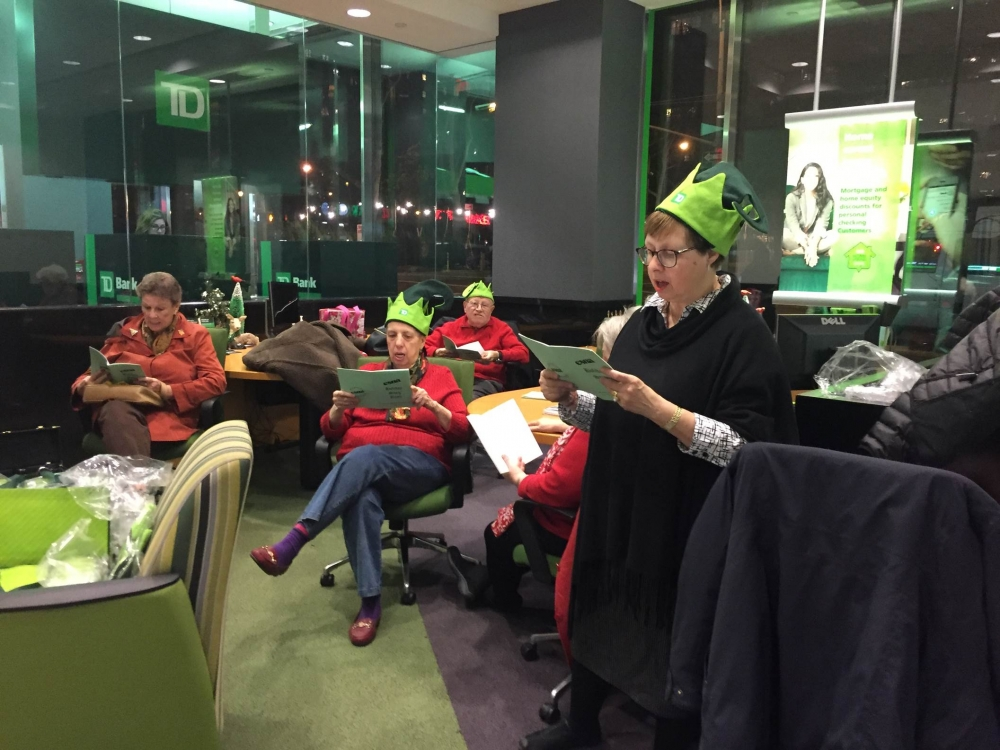 December 10, 2015--- TD Bank, Upper East Side---East Sixties Neighborhood Association's Co-Presidents Judy and Barry Schneider host a holiday sing for the residents of the East Sixties.