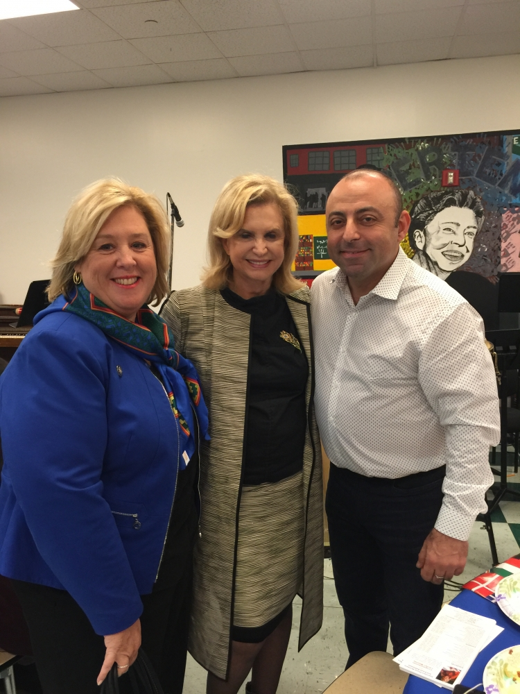 Assembly Member Rebecca Seawright, Congresswoman Carolyn Maloney and Eleanor Roosevelt High School Principal Dimitri Saliani at the Eleanor Roosevelt High School International Potluck Dinner.<br />