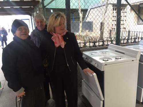 Seawright with tenants--new stoves arrived for installation in Robbins Plaza homes.