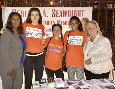 (L-R) Public Advocate Letitia James, volunteers Dea, Violet, and Natasha, and Assembly Member Rebecca Seawright.<br />