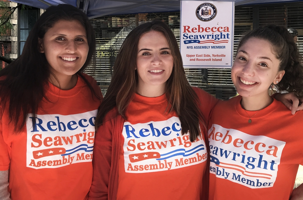 Volunteer Ila, Seawright Chief of Staff Katarina Matic and volunteer Violet at the street fair. <br />