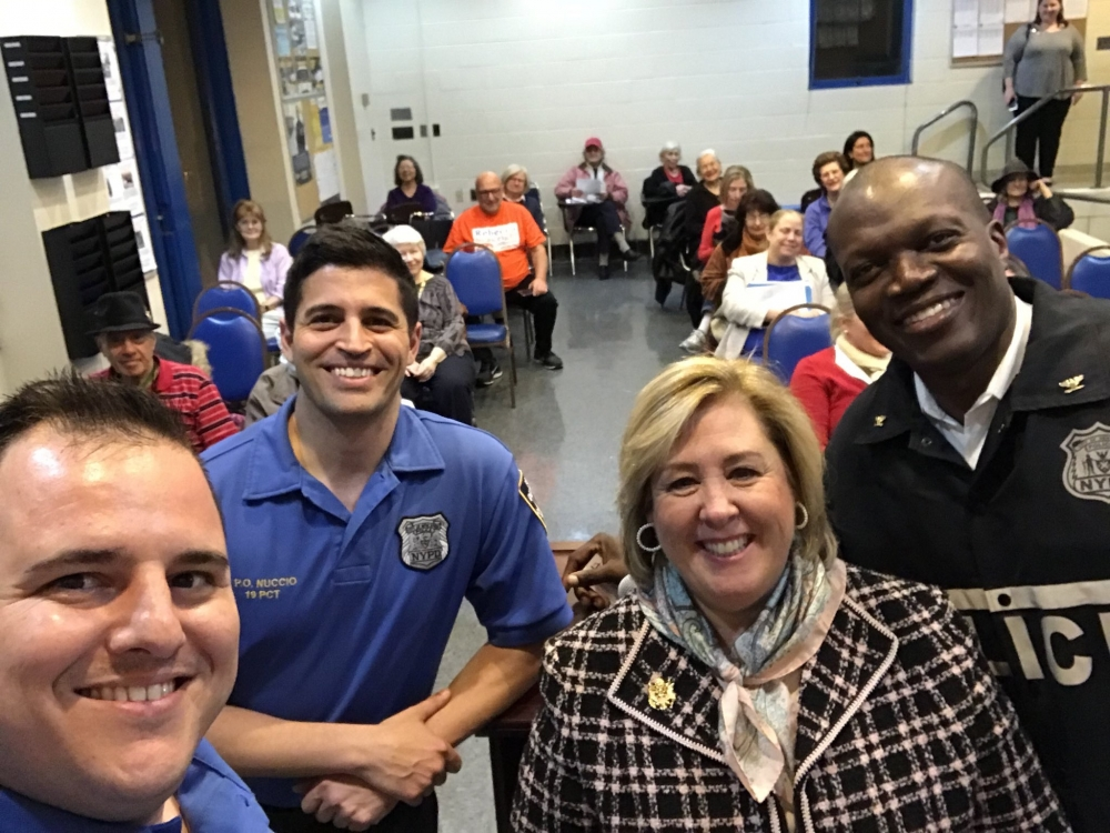 On Monday, November 20, Assembly Member Seawright hosted a Crime Prevention Forum with the Officers of the 19th Precinct.  Crime Prevention Officers Larkin and Nuccio, Assembly Member Seawright, and Commanding Officer Inspector McPherson take a selfie with the audience. <br />