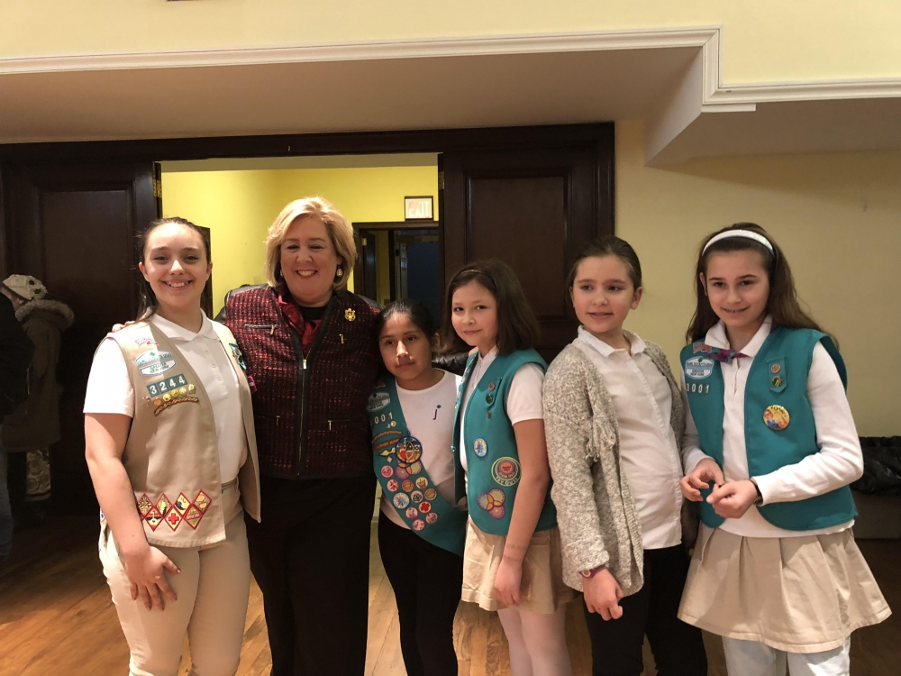 Roosevelt Island Girl Scout troop 3001 started the program, leading the Pledge of Allegiance<br />