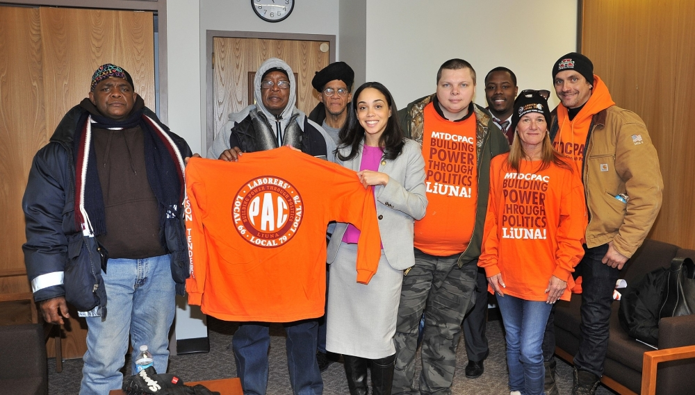 Assembly Member Latoya Joyner stands with Building and Construction Trades Council members.
