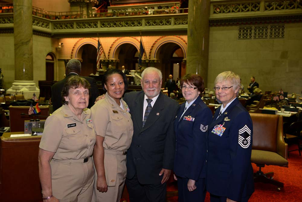 Mr. Rivera supporting women rights with members of the Air Force.