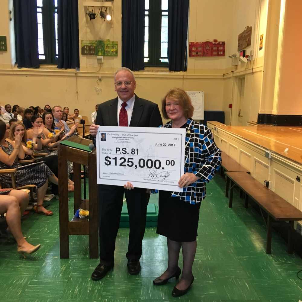 Assemblyman Dinowitz attending the June 22nd Graduation Ceremony of PS 81 pictured here presenting Principal Anna Kirrane with a technology grant check for $125,000.