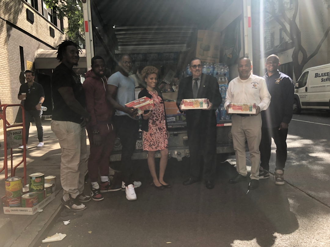 Speaker Heastie and Consul General Larry Cartwright put together food drive for people affected by the hurricane in the Bahamas.