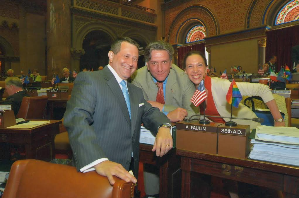 Majority Leader Joe Morelle and Assemblyman Matt Titone pose for a photo with Assemblywoman Paulin as the 2014 session comes to a close.