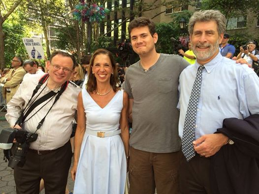 Amy Paulin at the �Standing with Israel� rally on July 28 at Dag Hammarskjold Plaza. Here with Rabbi Lester Bronstein, his son, and New Rochelle resident Michael Turek.
