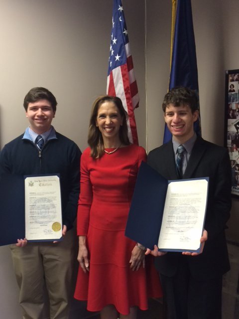 Pelham's Max Pine (l) and Scarsdale's David Frank joined Amy Paulin on Jan. 28 at her District office to receive certificates of achievement for their scientific work for the Intel Science Talent Sear