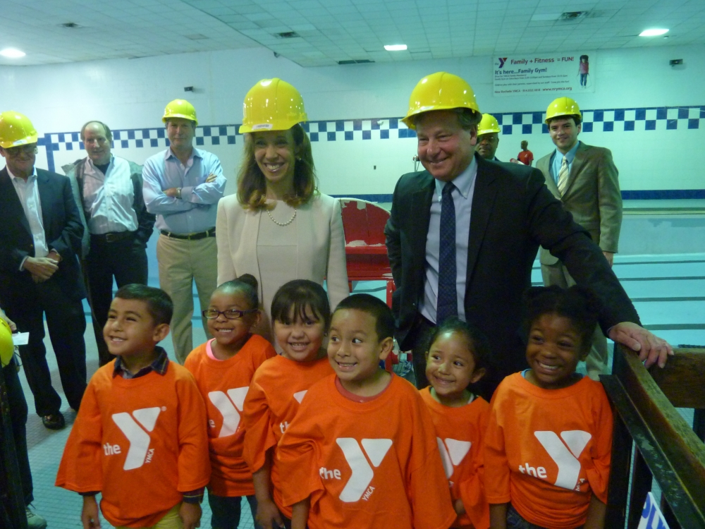 Assemblywoman Amy Paulin and Assemblyman Steve Otis with the children who use the New Rochelle YMCA pool. Paulin and Otis presented the YMCA with a check for $1 million to renovate the pool.