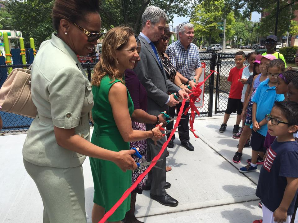 Assemblywoman Amy Paulin takes part in the ribbon-cutting ceremony for the new playground in the city's Kittrell Park. Paulin helped secure some of the funding to rebuild the playground.