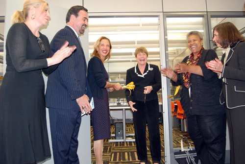 Assemblywoman Amy Paulin and Sen. Suzi Oppenheimer cut the ribbon on a new computer lab in New Rochelle's public library.